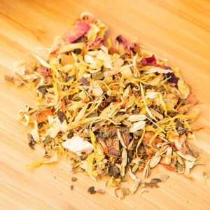 Ambika's Tree loose-leaf, herbal tea blend: Candied pineapple, candied mango, pineapple flakes, mango flakes, orange slices, freeze-dried tangerine pieces, safflower, marigold blossoms, freeze-dried strawberry slices