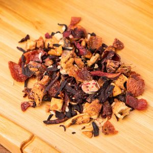 Apple Colada loose-leaf, herbal tea blend: Apple pieces, hibiscus blossoms, rosehip peel, candied pineapple cubes, coconut shreds