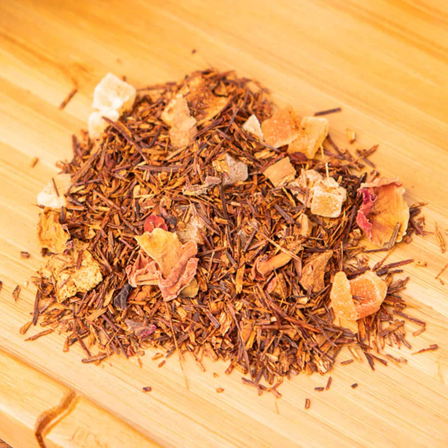 Apple Pie loose-leaf, herbal tea blend: Rooibos, candied pineapple, candied papaya, apple, orange peels, cinnamon, rose buds, rose petals