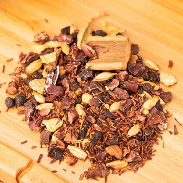 Aztec Chai loose-leaf, herbal tea blend: Cocoa pieces, rooibos, ginger, chicory root, barley malt, cinnamon, cinnamon sticks, natural flavor, cardamom, black pepper