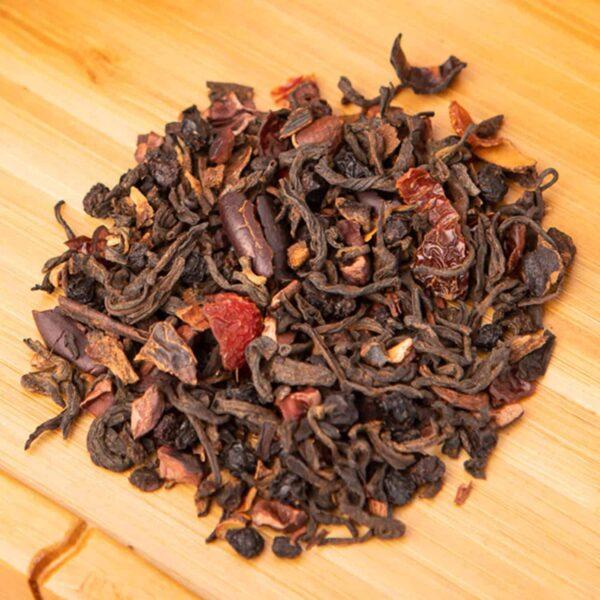 Black Wolf loose-leaf tea blend: Carob, cocoa nibs, rose hips, pu-erh, cacao nibs, blackberry, vanilla, honeybush, peppercorn, rose hips, elderberry