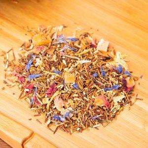 Honeyed Papaya loose-leaf, herbal tea blend: Green honeybush, candied papaya, candied mango, marigold petals, cornflower, rose petals