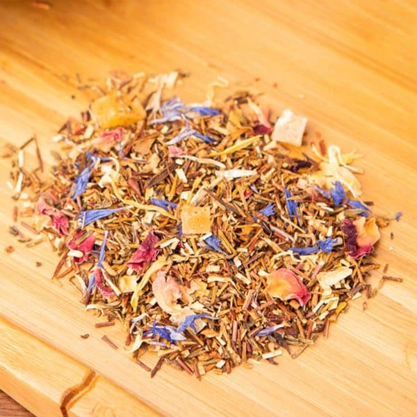 Honeyed Papaya loose-leaf, herbal tea blend: Green honeybush, candied papaya, candied mango, marigold petals, cornflower, rose petals