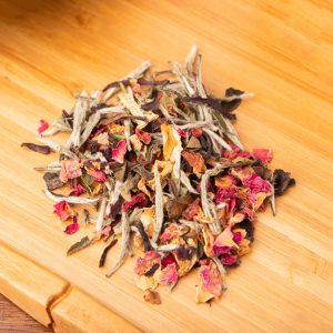 Moulin Rouge loose-leaf, white tea blend: Silver Needle, hibiscus flower, lemon peel, red rose petals, rose hips, apple pieces