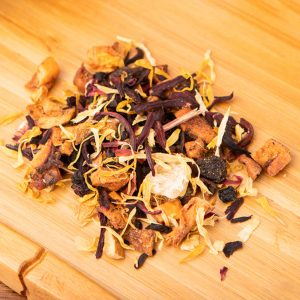 Peach Apricot loose-leaf, herbal tea blend: Hibiscus, apple, raisins, apricot, candied pineapple, elderberries, natural flavor, peach, lemon, marigold petals