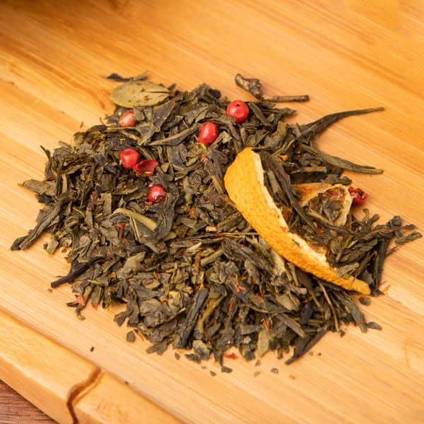 Winter Pine loose-leaf, green tea blend: Green tea, orange slices, planed almonds, pink peppercorns, safflower
