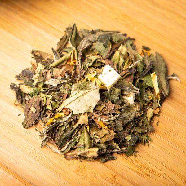 Mango Apple loose-leaf tea blend: Bai Mu Dan white tea, apple pieces, mango cubes, marigold blossoms