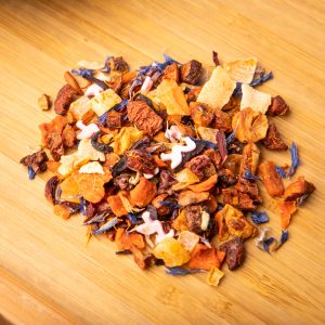 Pink Flamingo loose-leaf herbal tea: Apple pieces, candied papaya, carrot pieces, rose, sugar sprinkle flamingos, hibiscus petals, candied mango pieces, beetroot, coconut chips, safflower petals, cornflower petals