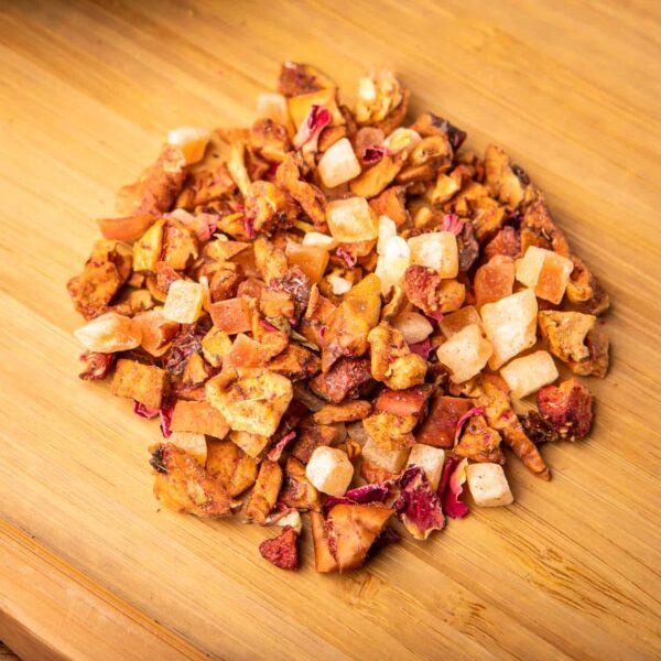 Blushing Strawberry loose-leaf herbal tea: Apple, papaya cubes, rose petals, strawberry, pink cornflower blossoms