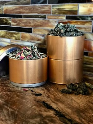 3-part stacking tin. About two ounces of tea fits in each chamber.