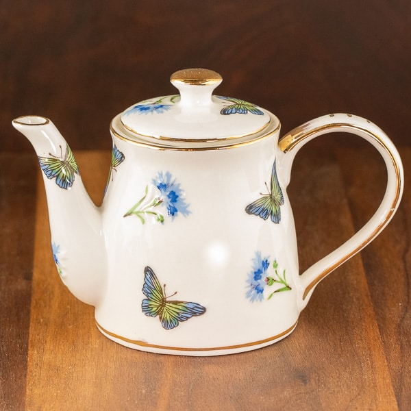 blue and white butterfly design teapot
