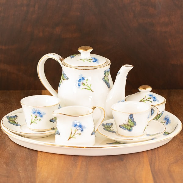 white and blue butterfly design teaset