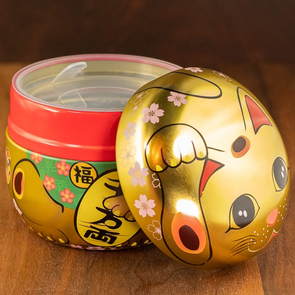 cat gold color tin with lid off