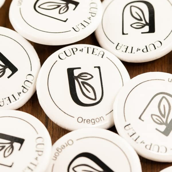 white color cup of tea logo pins